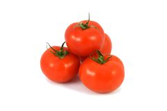 Tomater som isoleras på vit Arkivfoto