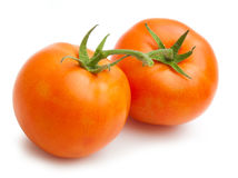 Tomater som isoleras på vit Royaltyfria Foton