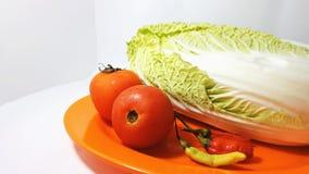 Tomaterna, chili och den Chinesee kålen fotografering för bildbyråer