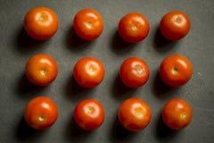 12 tomates Foto de Stock Royalty Free