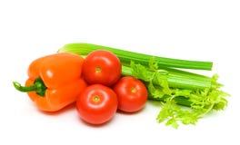 Tomates, aipo e pimentas isolados no fundo branco Fotografia de Stock Royalty Free