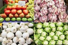 Tomates, ajos, cebollas y lechugas del mercado Foto de archivo