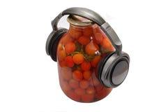 Tomates avec des écouteurs Image stock