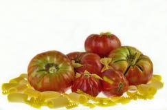 Tomates avec des pâtes Photos libres de droits