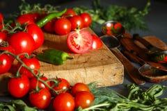 Tomates avec des pappers verts Photos libres de droits