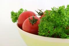 Tomates avec le persil Photographie stock libre de droits
