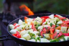 Tomates, calabacín, peper, cebolla cocinada Imagenes de archivo