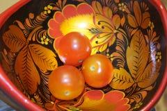 Tomates-cerises dans Hohloma Photographie stock