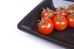 Tomates-cerises dans une plaque Photographie stock libre de droits