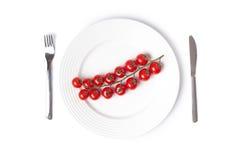 Tomates-cerises de plaque Photographie stock