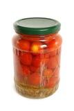 Tomates-cerises en boîte dans le pot en verre Images libres de droits