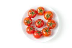 Tomates-cerises fraîches de plaque Photos stock