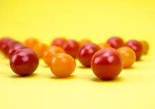 Tomates-cerises rouges et oranges Images libres de droits