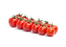 Tomates-cerises sur le blanc Photographie stock libre de droits