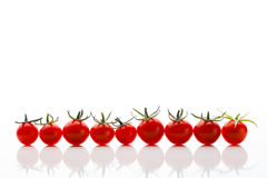 Tomates-cerises sur le blanc Photo stock