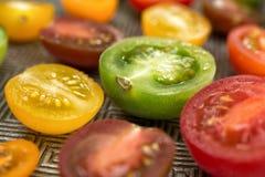 Tomates coloridos em uma placa Fotos de Stock