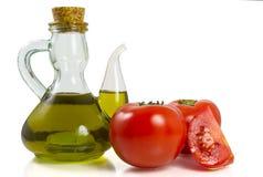 Tomates com petróleo Foto de Stock