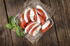 Tomates con la mozarela Imagenes de archivo