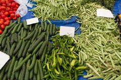 Tomates, concombres, poivrons et haricots Photographie stock libre de droits