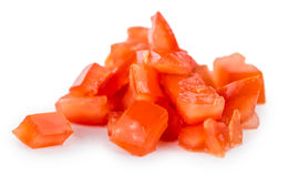 Tomates cortados en cuadritos aislados en blanco Imagen de archivo