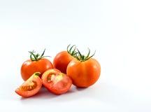 Tomates cortados en el fondo blanco Imagen de archivo