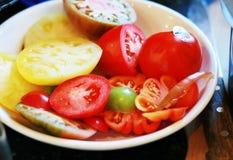 Tomates coupées en tranches d'héritage image libre de droits