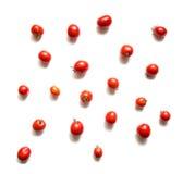 Tomates d'isolement sur la vue supérieure blanche Photographie stock