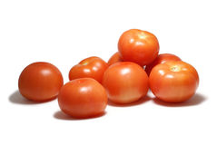 Tomates d'isolement sur le blanc Photos stock