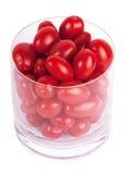 Tomates de ameixa no vidro Foto de Stock
