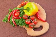 Tomates de cereja, aneto e pimento frescos Imagem de Stock Royalty Free