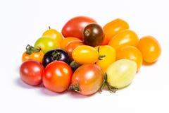 Tomates de cereja coloridos imagens de stock