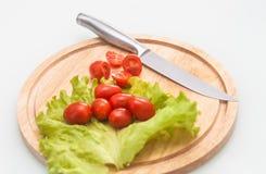 Tomates de cereja do corte Foto de Stock Royalty Free