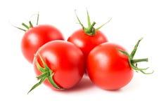 Tomates de cereja frescos no fundo branco, no alimento cru e no vegetabl Fotografia de Stock Royalty Free