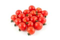Tomates de cereja isolados no fundo branco imagens de stock royalty free