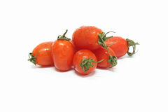 Tomates de cereja no fundo branco Fotografia de Stock Royalty Free