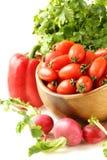 Tomates de cereja, rabanetes, pimentas e salsa Foto de Stock