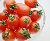 Tomates de cereza Imagenes de archivo