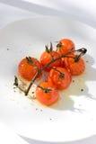 Tomates de cereza asados Fotografía de archivo libre de regalías