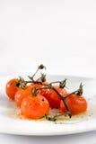 Tomates de cereza asados Fotos de archivo libres de regalías