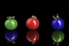 Tomates de cereza coloreados Imagen de archivo