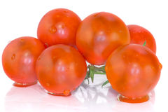 Tomates de cereza con la reflexión Foto de archivo