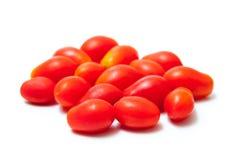 Tomates de cereza empilados Imagen de archivo libre de regalías