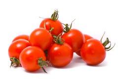 Tomates de cereza en blanco del estudio Fotos de archivo