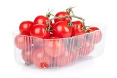 Tomates de cereza en el empaquetado Imagen de archivo