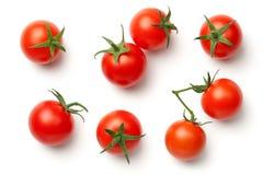 Tomates de cereza en el fondo blanco Imagen de archivo