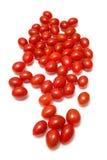 Tomates de cereza en un fondo blanco del estudio. Imagen de archivo