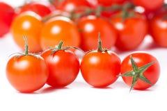 Tomates de cereza jugosos Imágenes de archivo libres de regalías