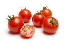 Tomates de cereza madurados vid imagenes de archivo