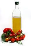 Tomates de cereza, pimienta dulce y aceite de oliva Imagen de archivo libre de regalías