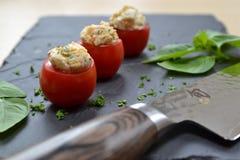 Tomates de cereza rellenos Imagen de archivo libre de regalías